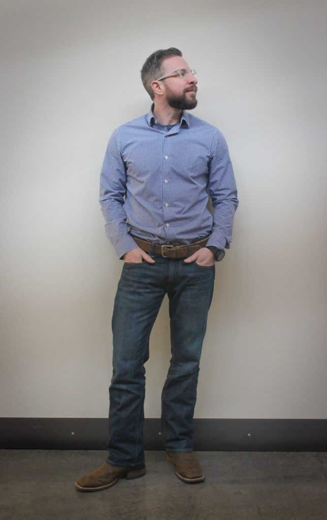 Ryan Sallans standing in contemplation.