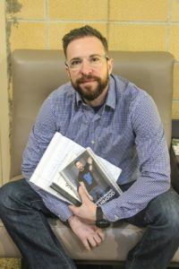 Ryan Sallans with his two memoirs